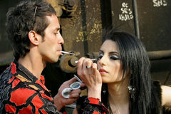 Preofessional make-up. A professional make-up artist doing his job Royalty Free Stock Images