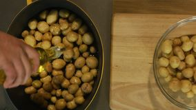 Potatoes. Prepairing young potatoes for baking in wood heated oven stock video