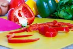 Preparação dos alimentos - pimentas de Bell Fotografia de Stock