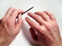 Preparação dos pregos na mão de um homem Fotos de Stock Royalty Free
