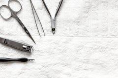 Preparação para o pedicure - ferramentas na opinião de tampo da mesa Foto de Stock Royalty Free