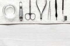 Preparação para o pedicure - ferramentas na opinião de tampo da mesa Imagens de Stock