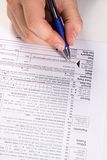 Preparando impostos Fotografia de Stock