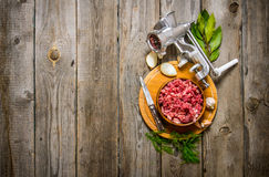 Preparated minced meat in a bowl , grinder and spices with herbs. Stock Images