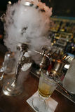 Preparation of absinth. Prague, Czech Republic - June 02, 2017 - preparation of traditional absinthe in bar on old town of prague Royalty Free Stock Photos