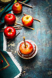 Preparation of apples with chocolate coating and chopped almonds making Stock Photos