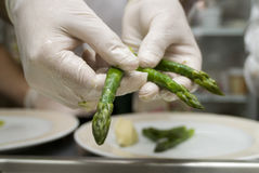 Preparation of an asparagus. A chef in a restaurant kitchen Stock Photos