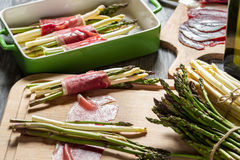 Preparation asparagus with prosciutto ham stock image