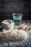 Preparation for baking delicious and traditionally dough for bread. On old wooden table Royalty Free Stock Photography