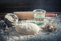 Preparation for baking delicious and traditionally dough for pizza. On old wooden table Stock Photography