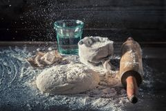 Preparation for baking traditionally and delicious dough for pizza. On old wooden table Royalty Free Stock Images