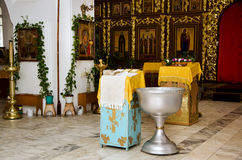 Preparation for baptism in the Orthodox Church. With the baptismal font and the lectern Royalty Free Stock Photography