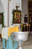 Preparation for baptism in the Orthodox Church. With the baptismal font and the lectern stock photography