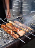 Preparation of barbecue meat shish kebab on skewers grill food Royalty Free Stock Image