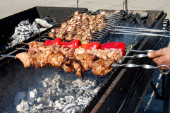 Preparation of barbecue meat shish kebab on skewers grill food. Stock Photo