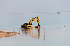 Preparation of the beach on the Dead Sea Royalty Free Stock Image