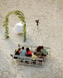 Preparation for beach wedding. Guests wait for sunset wedding on the beach stock photos