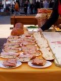 Preparation of big mortadella sandwich. ZAGREB, CROATIA - FEBRUARY 16, 2014: Promotion of Mortadella salami on Ban Jelacic square in Zagreb. Big sandwich is Royalty Free Stock Images