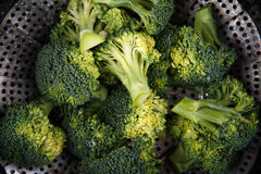 Preparation of broccoli to steam cooking Royalty Free Stock Photography