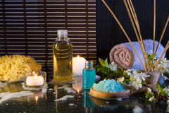 Preparation for the bubble bath and candles and diffuser essences Royalty Free Stock Photo