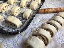 Preparation of buns with cinnamon at home. Stock Photo