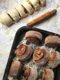 Preparation of buns with cinnamon at home. Stock Images