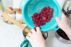Preparation of cake with cherries and raspberries. Royalty Free Stock Image