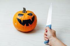 Preparation of carving jack-o-lantern pumpkin for Halloween stock image