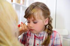 Preparation for children's photo shoot. Applying Stock Photo
