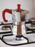 Preparation of coffee. Moka pot on a gas stove Royalty Free Stock Photos