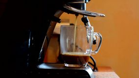 Preparation of coffee with coffee machine stock video footage