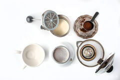 Preparation coffee set on the white background top view. Coffee maker , cups , coffee on the vintage metal plate and cappuccinator on the white background top royalty free stock photo