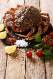 Preparation for cooking food spider crab with fresh ingredients. Close-up on a wooden table. vertical stock photography