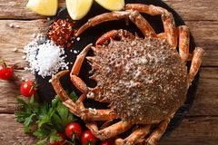 Preparation for cooking food spider crab with fresh ingredients. Close-up on a wooden table. horizontal top view from above stock photography