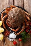 Preparation for cooking food spider crab with fresh ingredients. Close-up on a wooden table. Vertical top view from above royalty free stock images