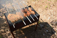 Preparation, Cooking kebabs on charcoal outdoor Royalty Free Stock Photos