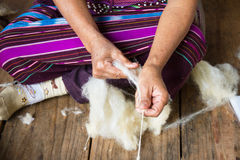 Preparation of the cotton fiber for weaving a garment. Royalty Free Stock Photo