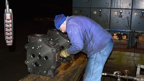 Preparation cover diesel engine testing. Cover mechanic prepares for testing Stock Images