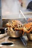 Preparation of Crab at the Fis. Fisherman preparing crab at the Fisherman's Wharf, San Francisco Stock Images