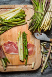 Preparation cuisine with asparagus and prosciutto royalty free stock photos