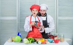 Preparation and culinary concept. happy couple in love with healthy food. man and woman chef in restaurant. Family stock photos