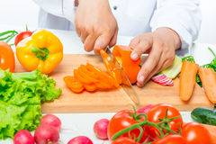 Preparation of cutting vegetables for salad, close up hands Stock Photos
