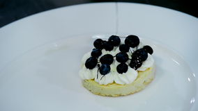 Preparation and decoration dessert biscuit, cream and berries stock video footage