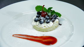 Preparation and decoration dessert biscuit, cream and berries stock video