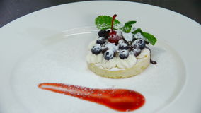 Preparation and decoration dessert biscuit, cream and berries stock footage