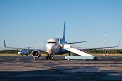 Preparation for the departure of passenger airplanes at the airport apron Royalty Free Stock Photo