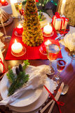 Preparation for dinner at Christmas table Royalty Free Stock Photo