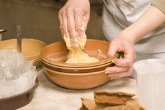Preparation of dough. Women making homemade pie. Dough mixing in a clay bowl stock photo