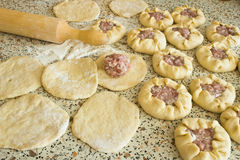 Preparation of dough and baking pies Stock Photos