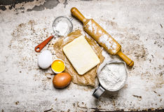 Preparation of the dough. Ingredients for the dough - Flour, eggs, butter with a rolling pin. Royalty Free Stock Photography